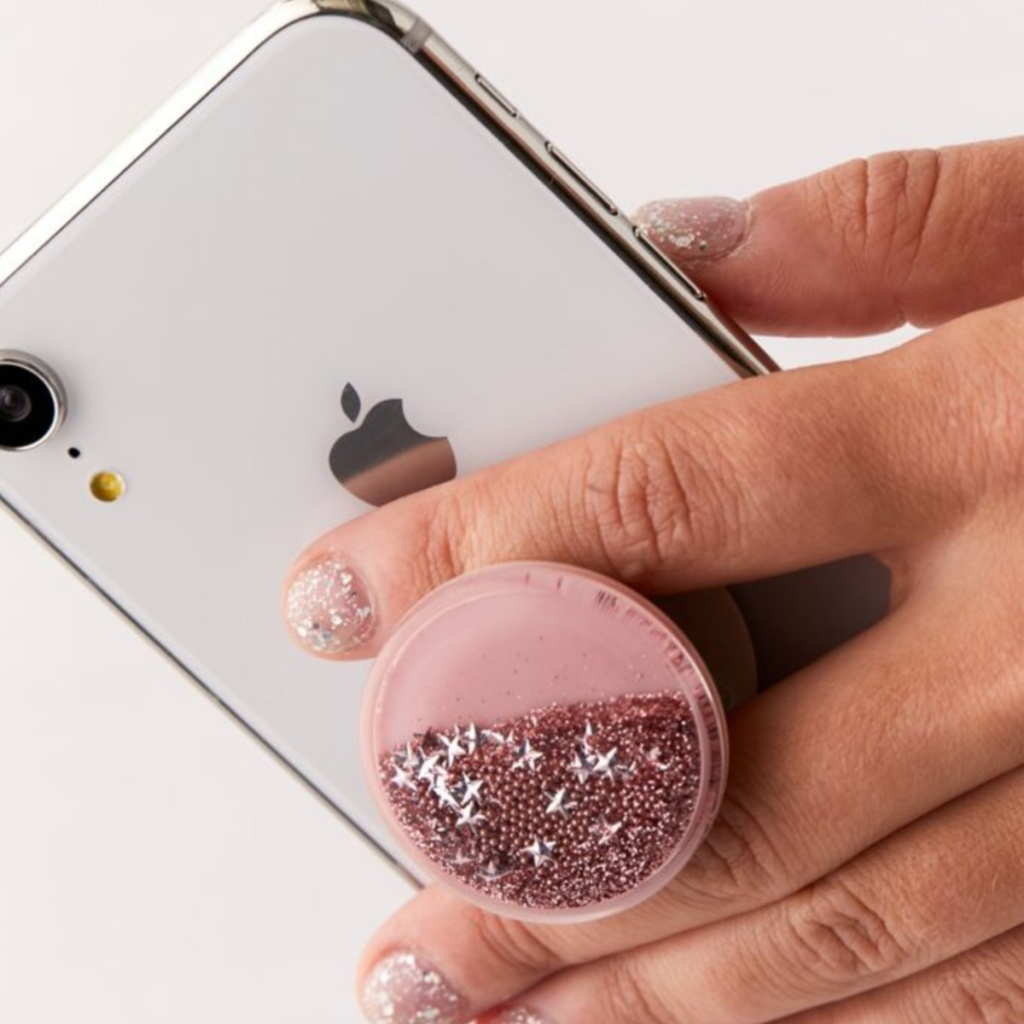 hand holding pink popsocket with glitter