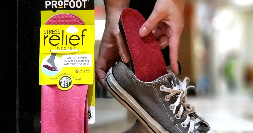 hand putting insole into casual sneaker and packaged insole