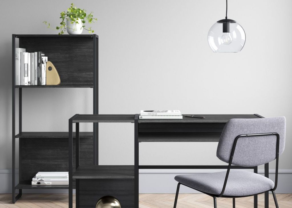 room with a desk, chair and bookshelf