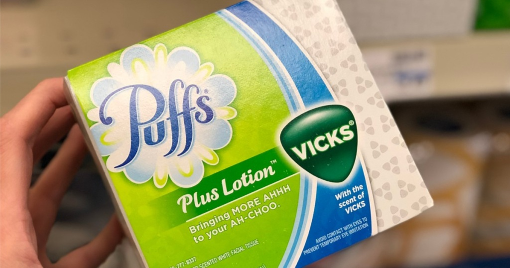hand holding puff's plus lotion Vick's in store