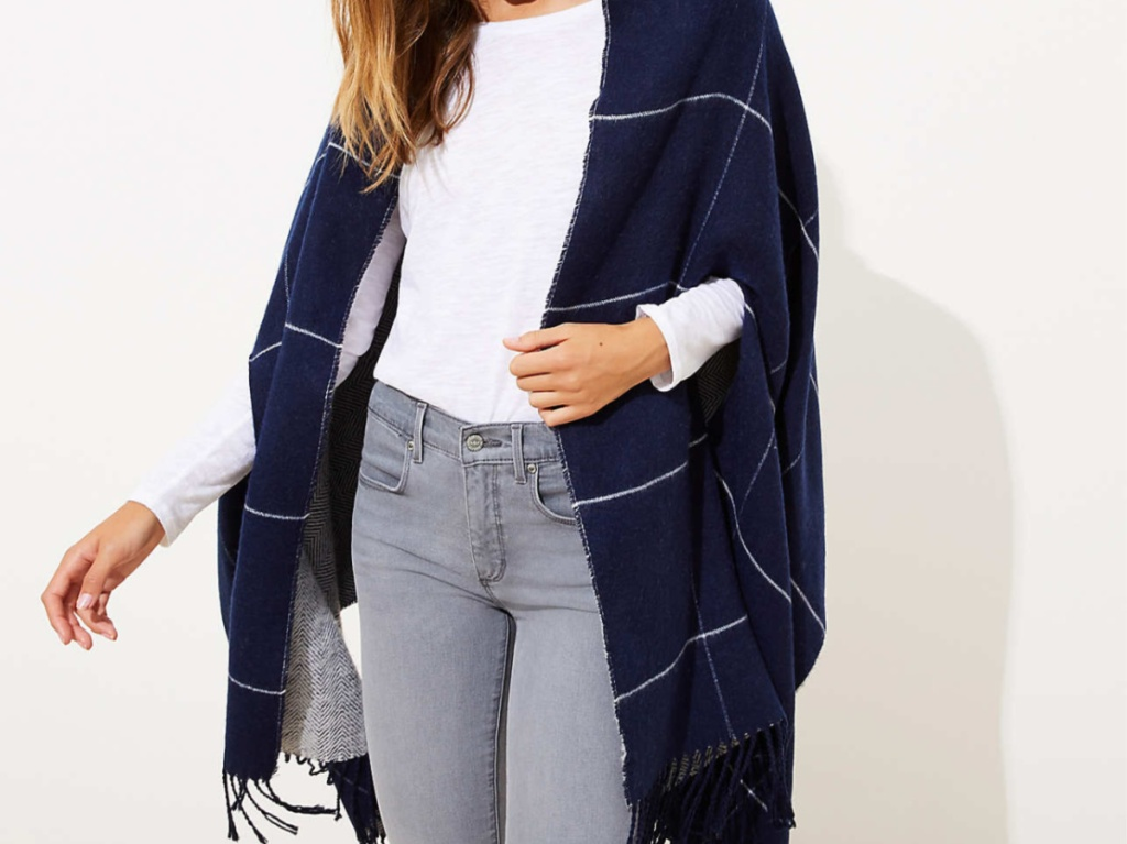 woman in dark blue fringe cape
