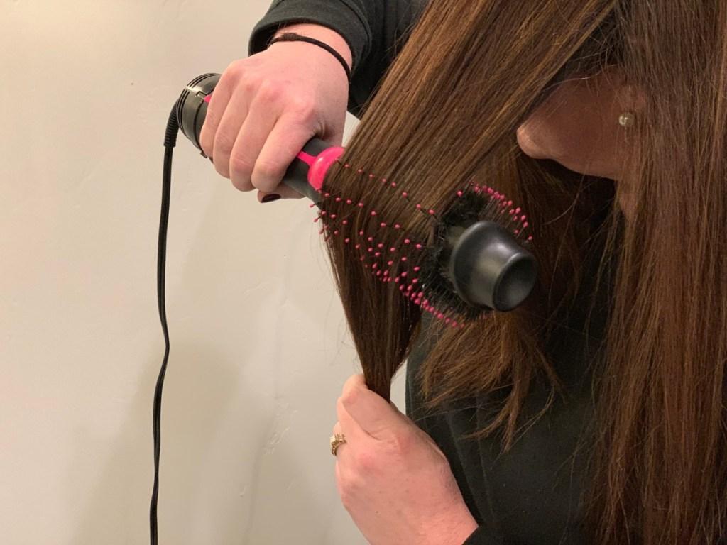 woman using Revlon hair dryer on her hair
