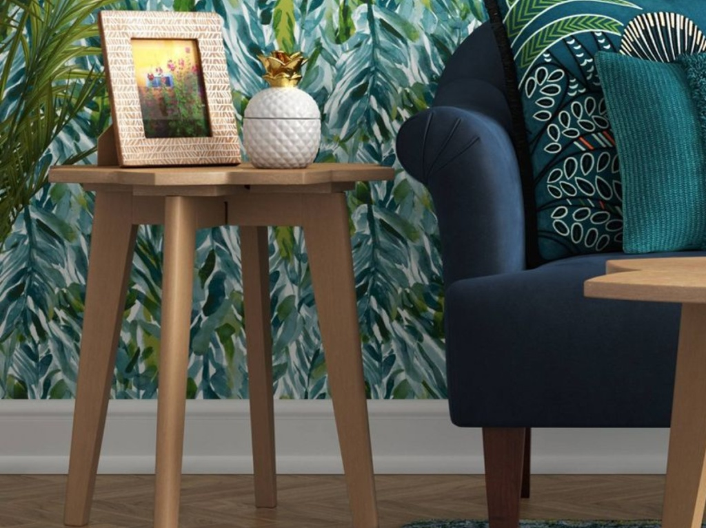 natural wood end table in living room next to blue couch