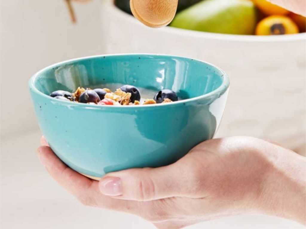 woman hand holding blue Rory Reactive Glaze Snack Bowl