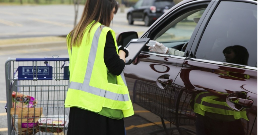 Sam's Club worker offering curbside delivery
