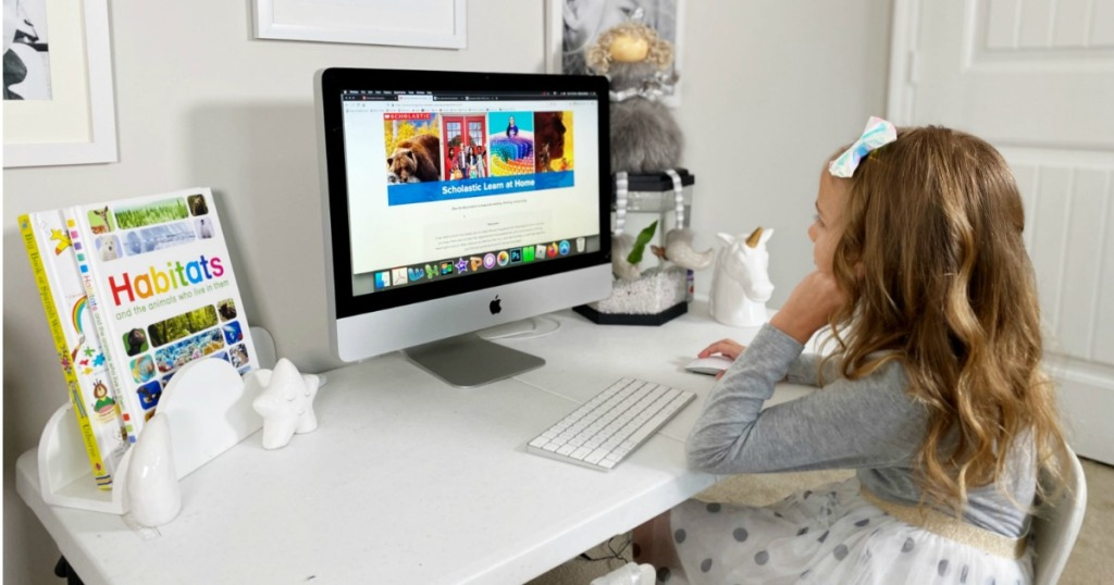 Girl playing Scholastic Learn at Home on computer