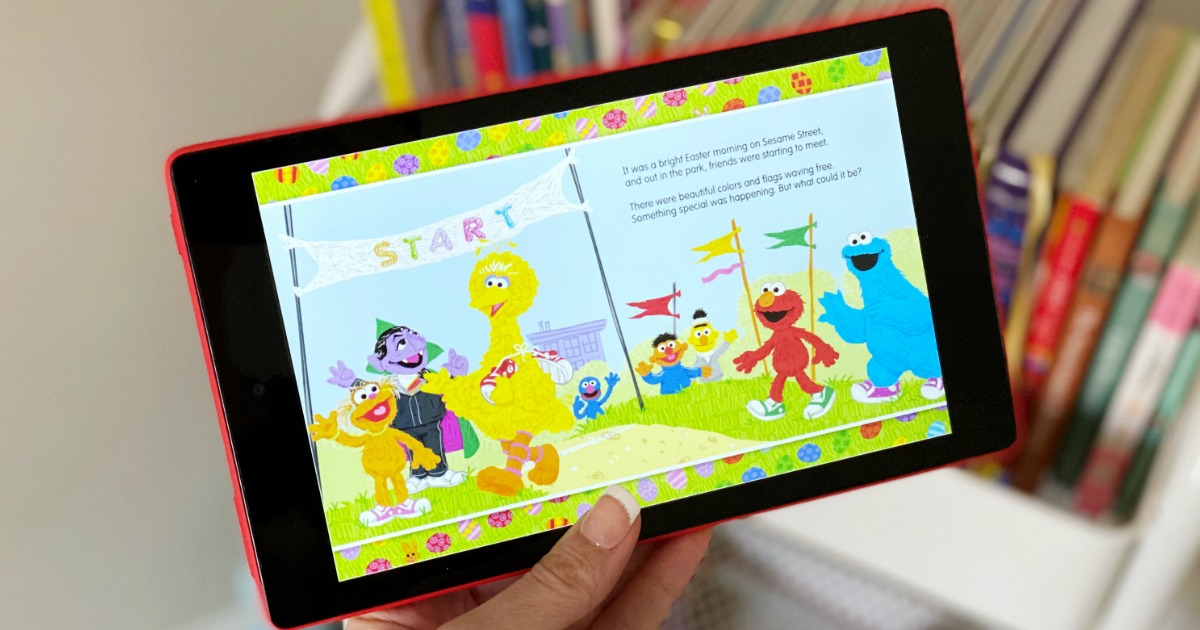 hand holding a tablet with a Sesame Street book on it