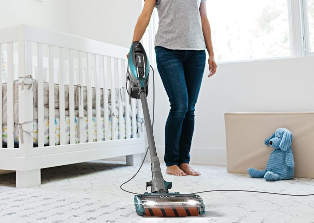 woman using a vacuum