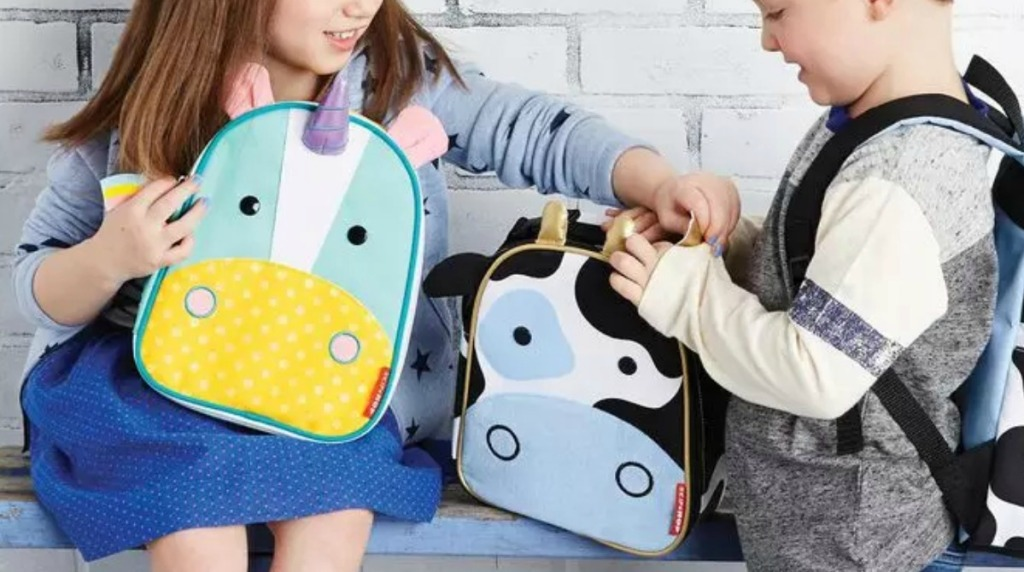 Two kids with zoo animal themed lunchboxes