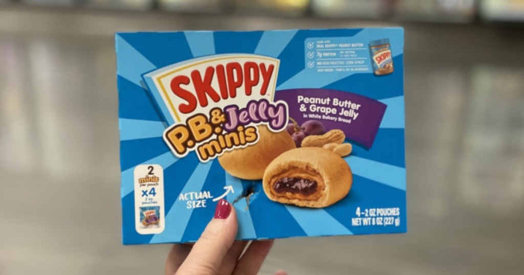 woman's Hand holding up a box of Skippy Minis