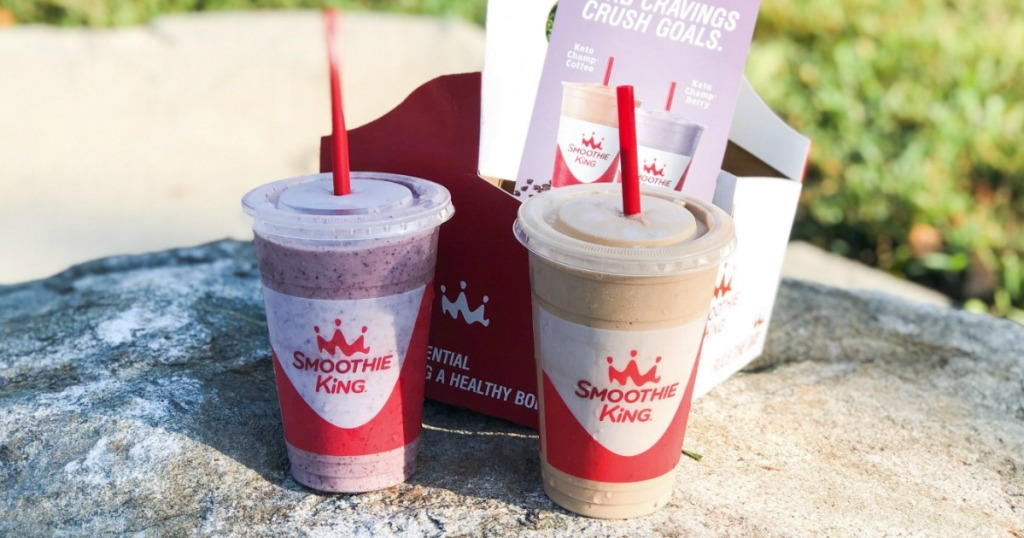 two Smoothie King Smoothies on a rock