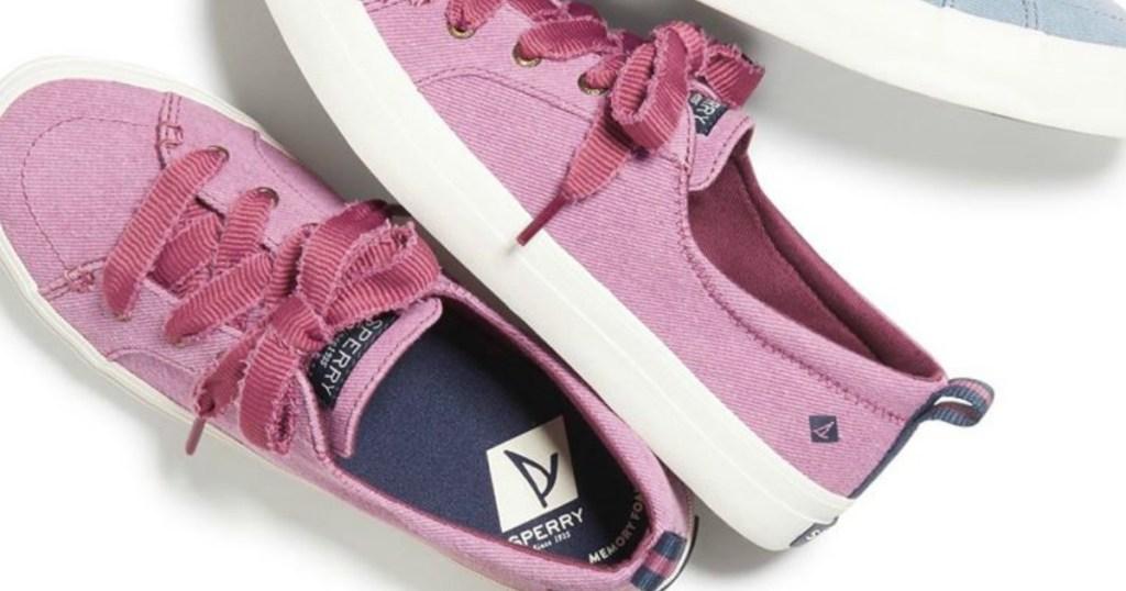 pair of pink Sperry sneakers