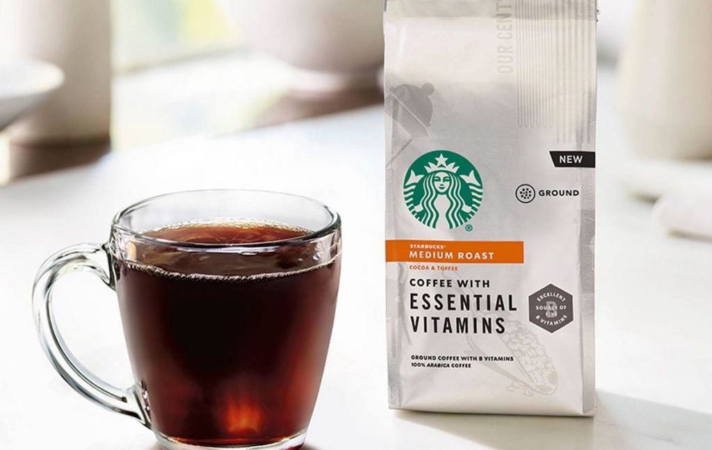 coffee cup next to bag of Starbucks Coffee
