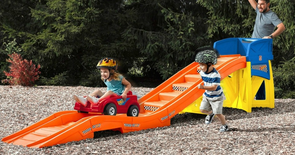 Kids riding on Step2 Hot Wheels Extreme Thrill Roller Coaster