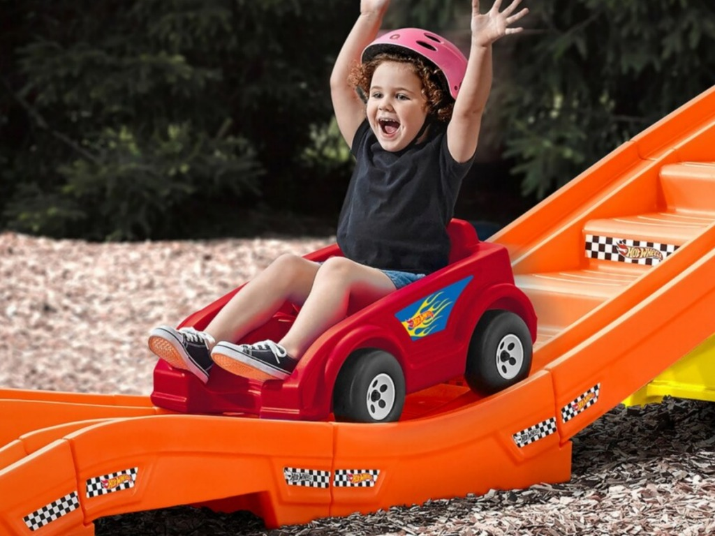 toddler girl riding Step2 Hot Wheels Extreme Thrill Roller Coaster