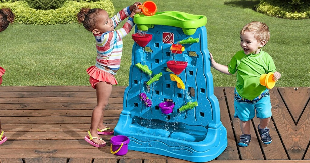 toddlers playing with Step2 Waterfall Discovery Wall