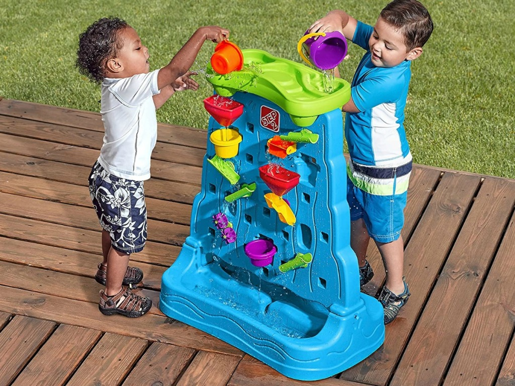 toddler boys playing with Step2 Waterfall Discovery Wall