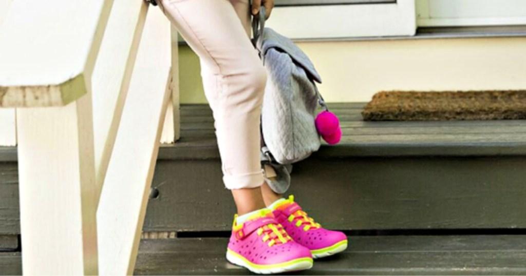 Stride Rite Girls Pink Made2Play Phibian Sneaker Sandal on girl on stairs
