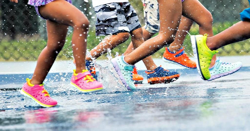 Stride Rite Phibian Sneaker Sandals on kids running in water