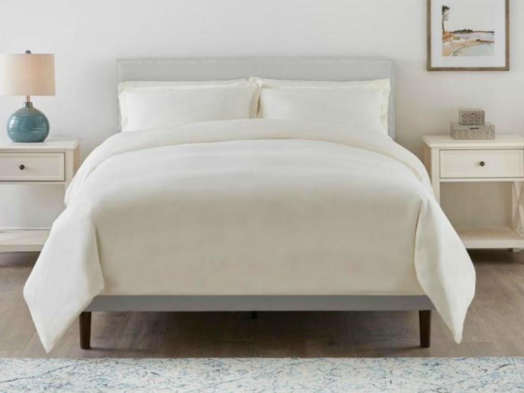 Gray headboard on coordinating bed in bedroom
