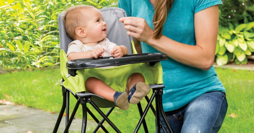 baby sitting in portable highchair