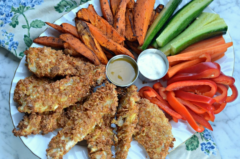 chicken fingers and veggies on plate