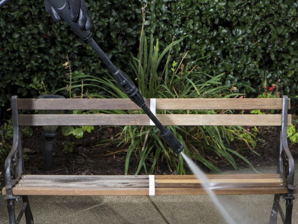 pressure washer hose being used on bench