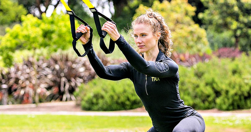 woman training with TRX All-In-One Suspension Training: Bodyweight Resistance System
