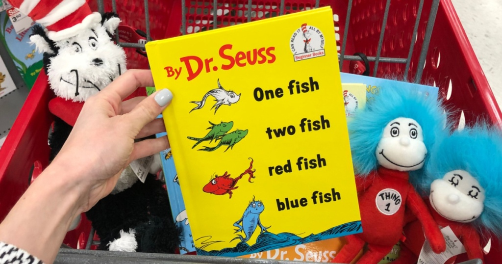 Hand holding Dr. Seuss Books