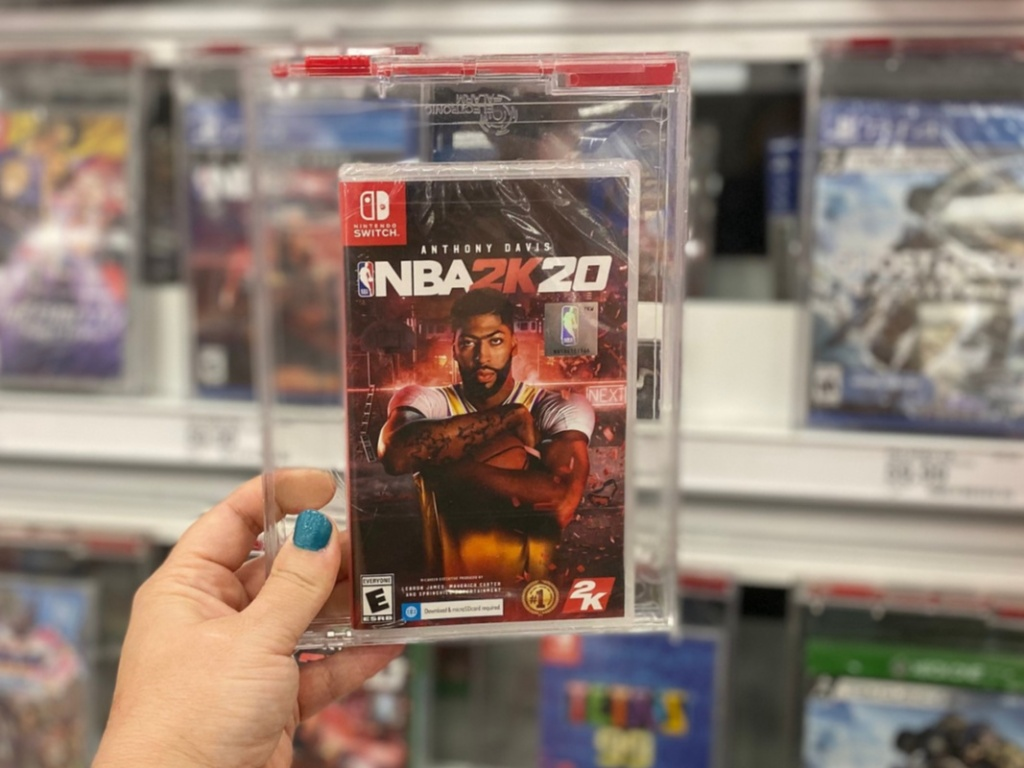 Hand holding NBA 2k20 for Nintendo Switch