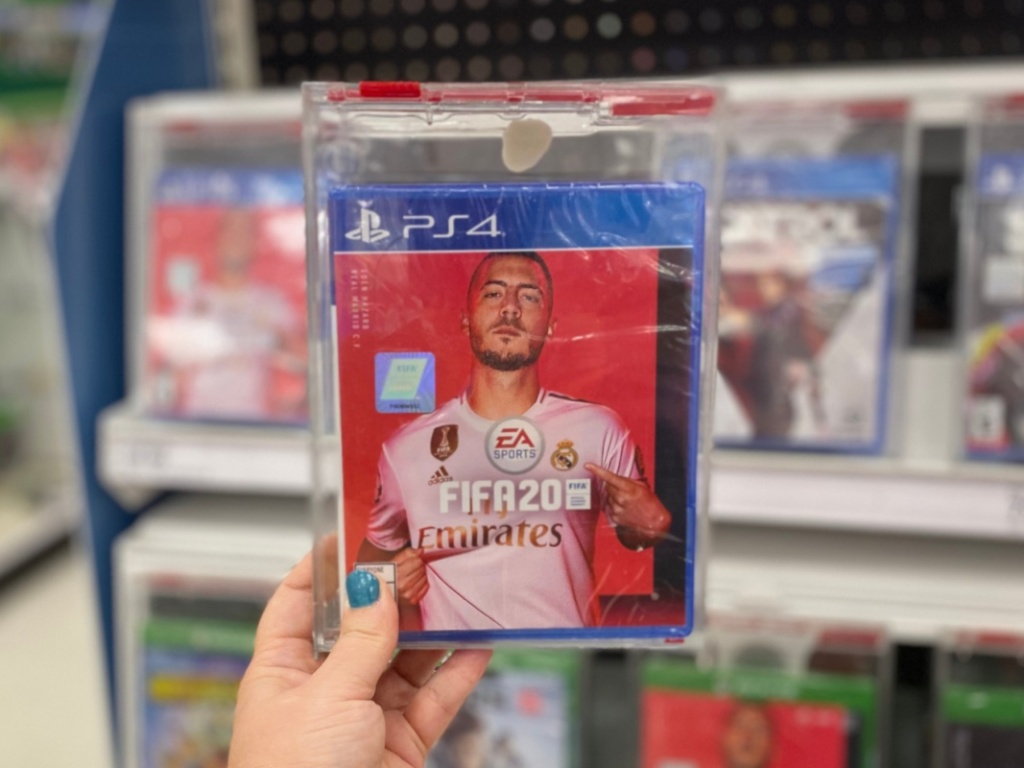 Hand holding FIFA 2020 playstation game at Target