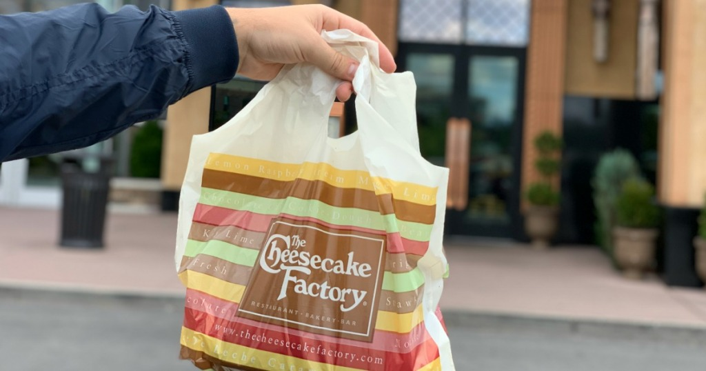 man holding The Cheesecake Factory Bag