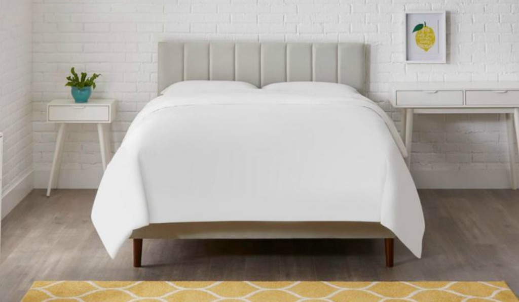 Queen sized bed with a gray tuft headboard