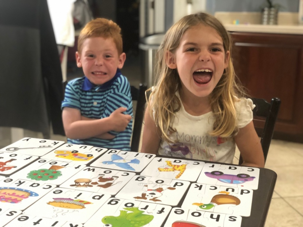 Kids playing The Learning Journey Puzzles on table