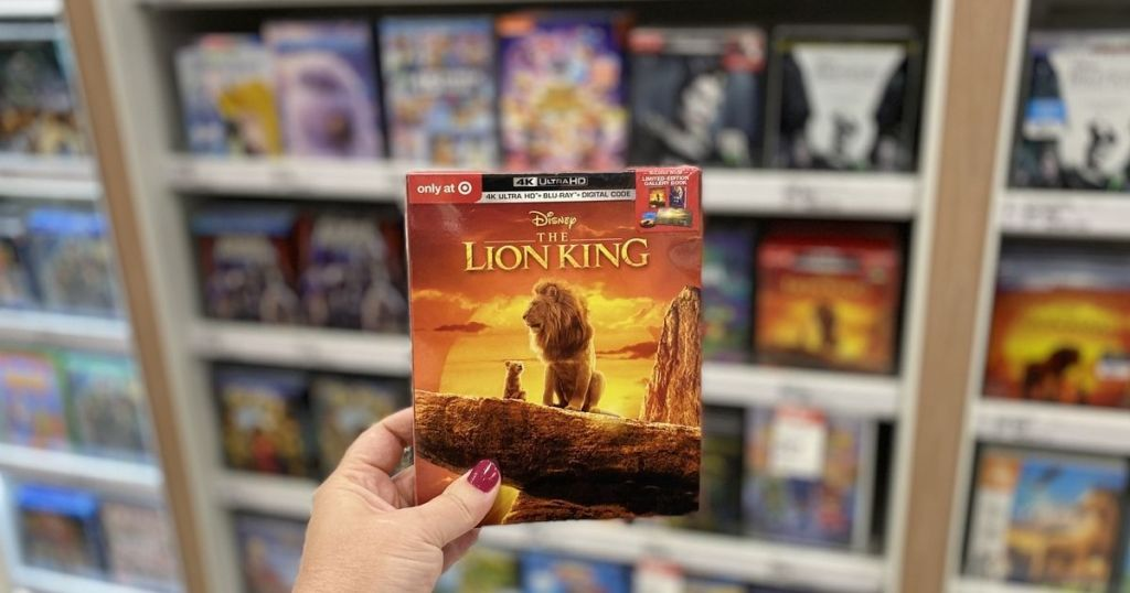 woman's hand holding Lion King DVD in store
