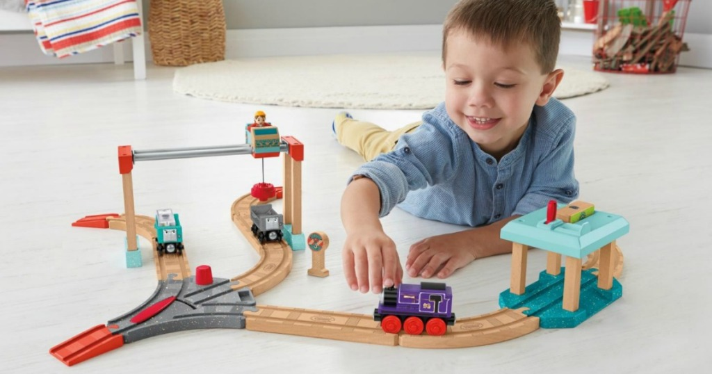Little boy playing with Thomas Train Set