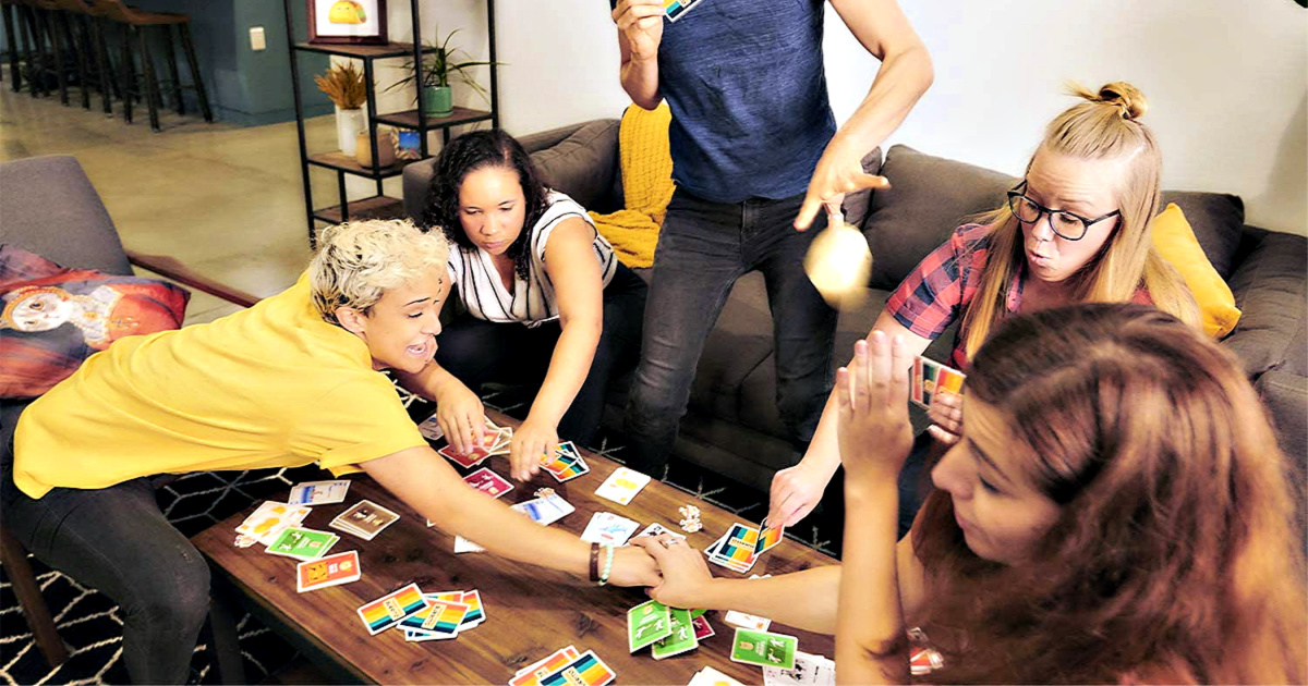 Throw Throw Burrito by Exploding Kittens being played by a group of people