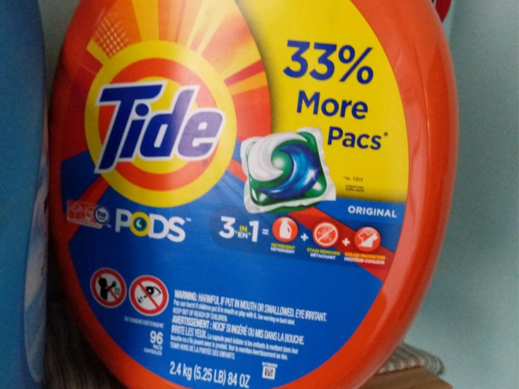 tub of laundry detergent pods on shelf in home