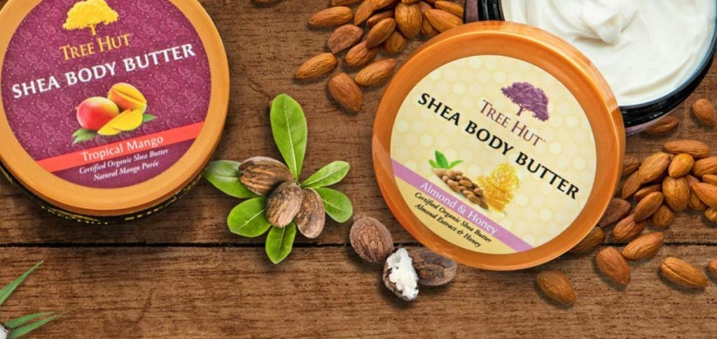 tree hut body butters with lid off surrounded by almonds