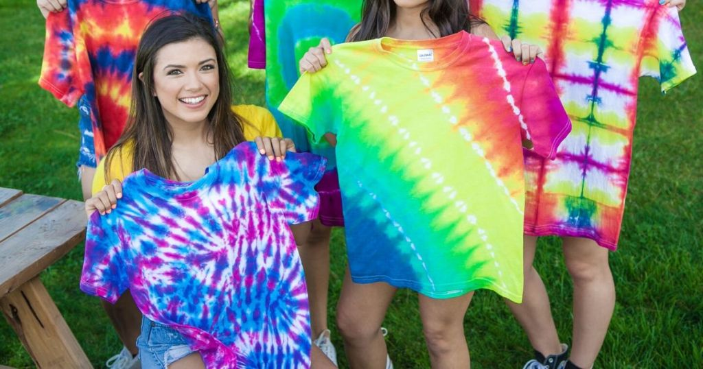 five girls holding up completed tie dye shirts