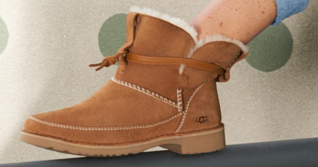 women's leg with brown ugg boot