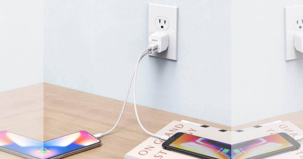 two phones plugged into Ultra-Compact USB Charger