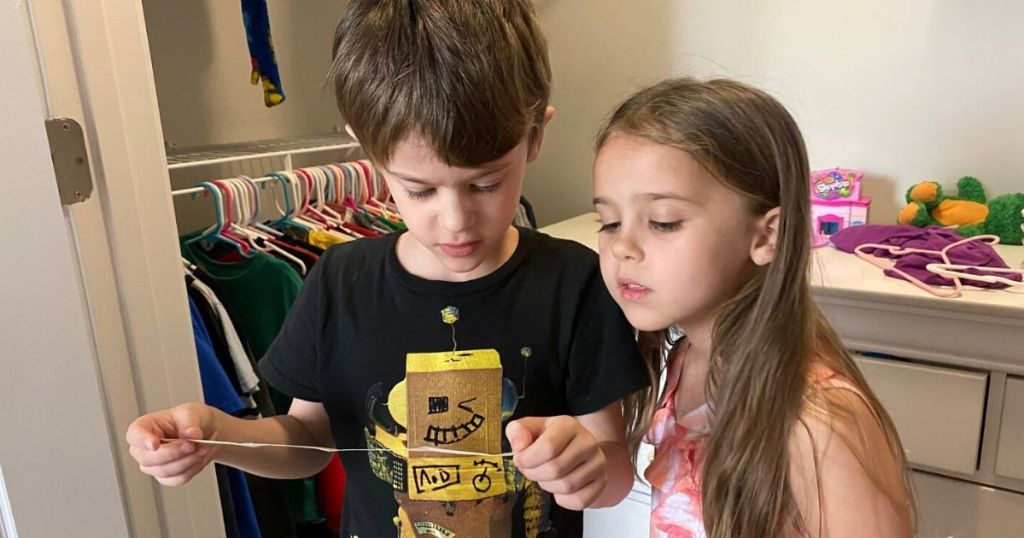 Two children reading scavenger hunt clue found in bedroom closet