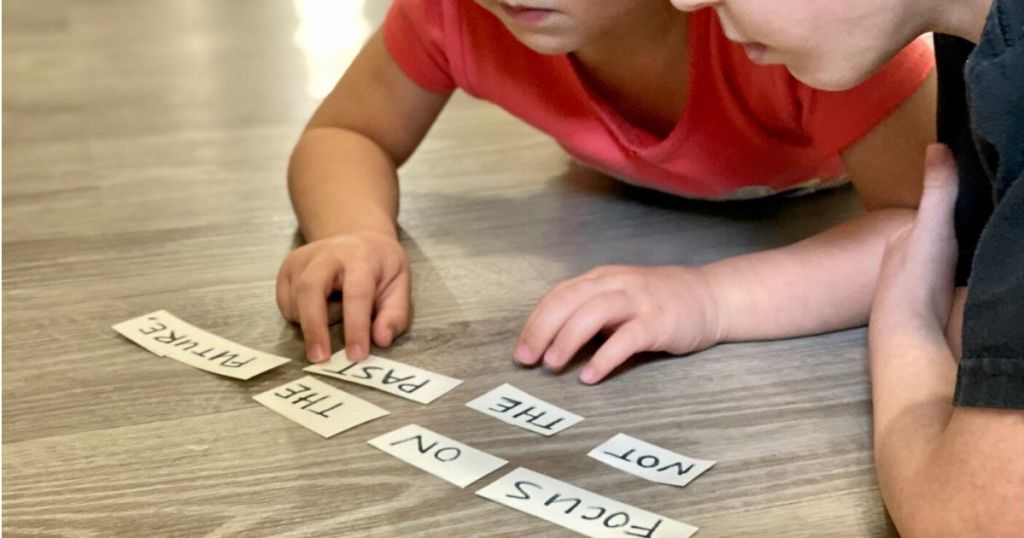 Two kids solving word jumble for obstacle course