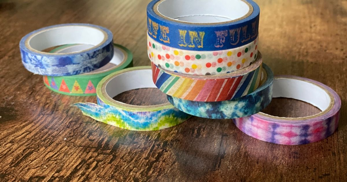 Washi tape sitting on table for DIY car track
