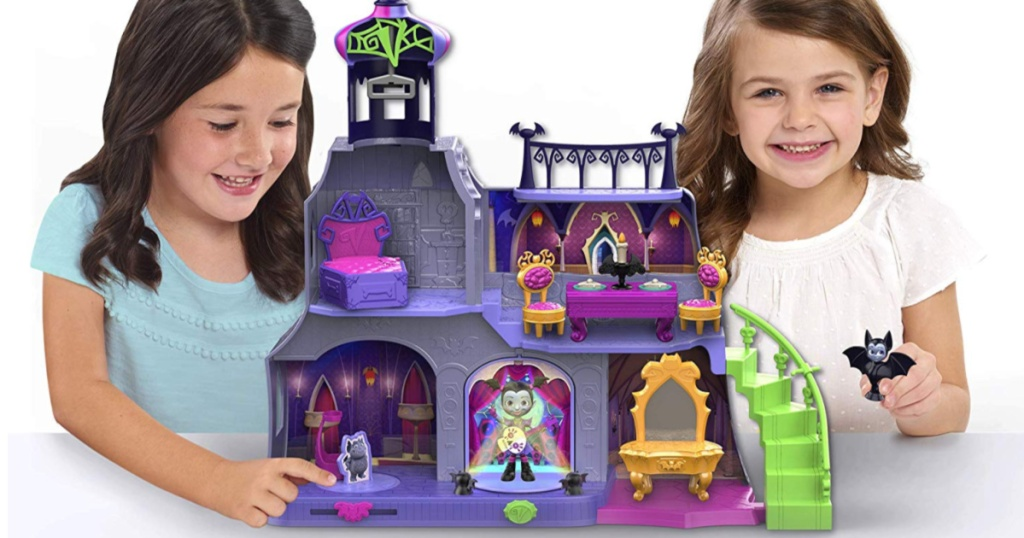 young girls playing with a kids castle toy