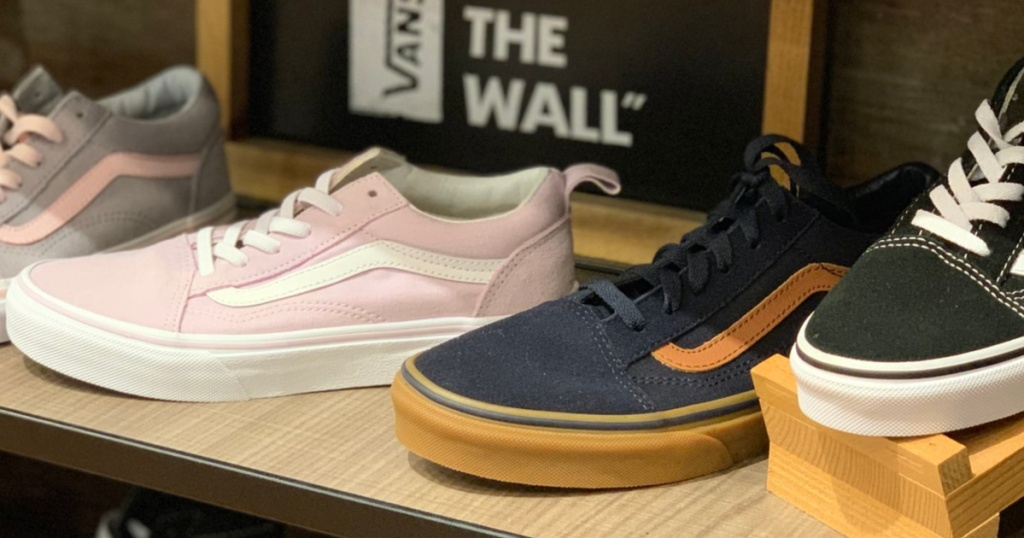 men and women's casual shoes on store shelf display
