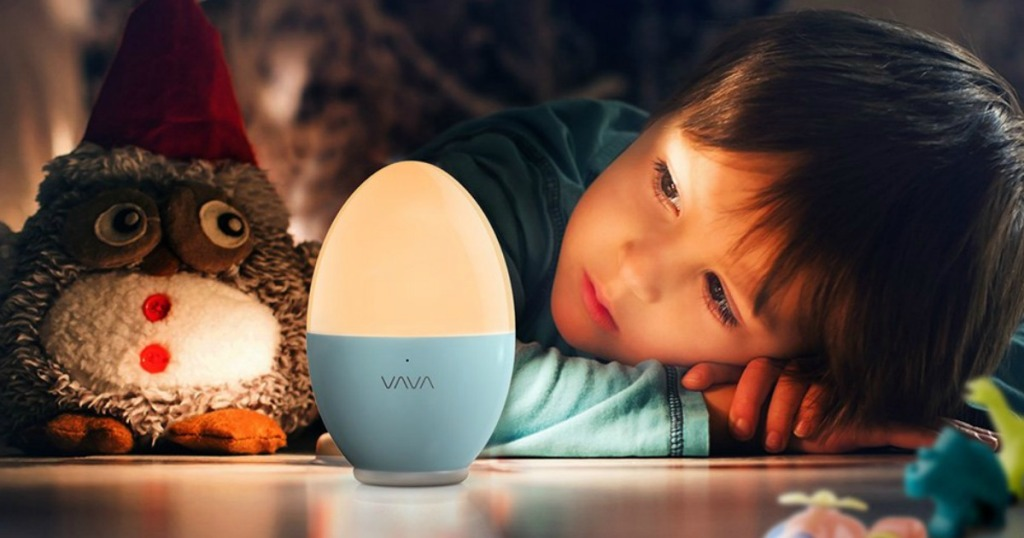 kid looking at a nightlight