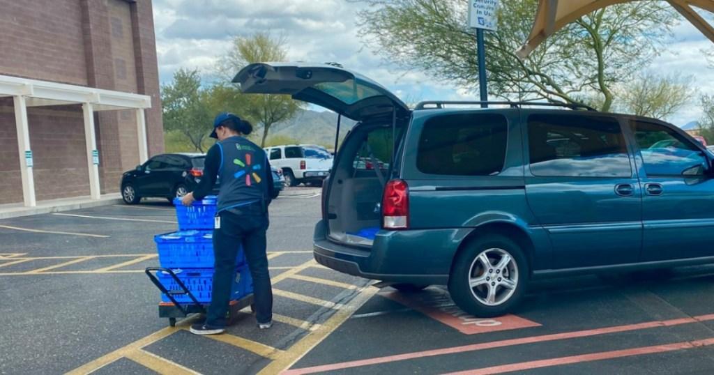 Walmart Grocery Pickup cashier putting bags in van