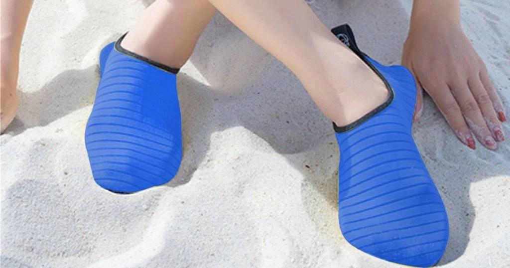 Person wearing blue aqua shoes